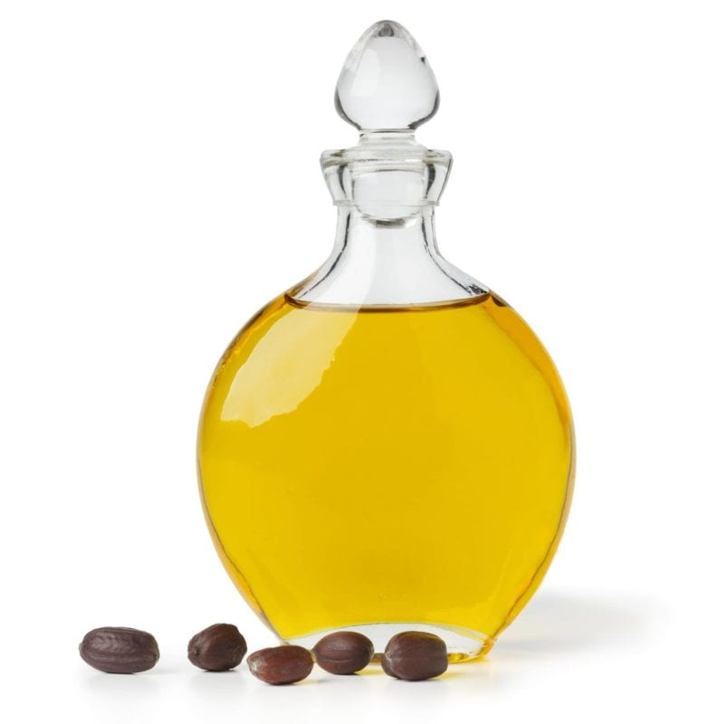 Botle of Jojoba oil and seeds